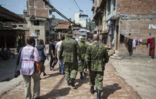 A representative from Canada's Department of Foreign Affairs, Trade and Development and other non-government organization partners take part in a reconnaissance patrol with members of the initial elements of the DART in Kathmandu, Nepal on May 1, 2015.  Photo: Captain Gabriel Rousseau, Canadian Forces Combat Camera