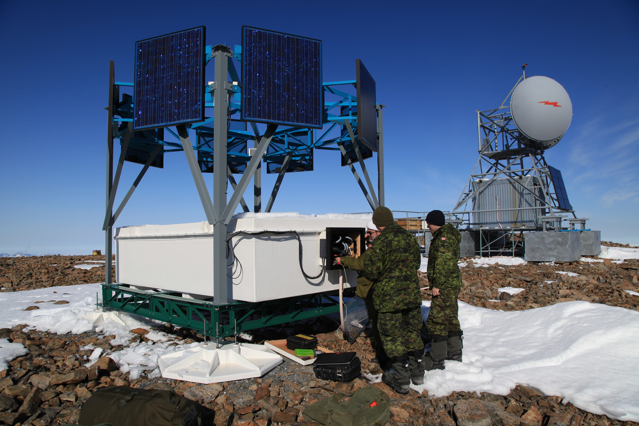 Ellesmere Island. 18 June 2015 – Mr. Yves Gauthier guides Master Corporal Marty Stride and Corporal Graeme Ross (CFS LEITRIM) through the maintenance program on one of the High Arctic Data Communication Systems Line of Sight Systems (HADCS LOS) Sites. (Photo:  Lieutenant-Navy Clayton Erickson, Joint Task Force (North))