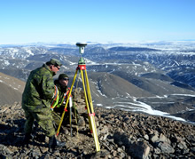 Master Corporal Corey Quinn and Corporal Mike Brajak from Canadian Forces Mapping and Charting Establishment Ottawa, Ontario mark boundary lines at the Grant High Arctic Data Communications System (HADCS) on June 11, 2016 during Operation NEVUS. (Photo: PO2 Belinda Groves, Task Force Imagery Technician)