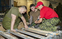 Resolute Bay, Nunavut. 3 April 2016. Members of 2nd Battalion, The Royal Canadian Regiment are taught how to prepare a Komatuk sled by a member of 1st Canadian Ranger Patrol Group at Resolute Bay, NU, in preparation for Operation NUNALIVUT on April 3, 2016. (Photo: Cpl Parks, Task Force Image Technician)