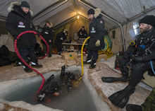 Gascoyne Inlet, Nunavut, 12 April 2014 - Clearance divers from Fleet Diving Unit (A) and Combat Divers from 2nd Division, 5 Combat Engineer Regiment conduct ice diving operations at the Combined Dive Team camp in Gascoyne Inlet, Nunavut during Operation NUNALIVUT. (photo by: Master Seaman Peter Reed, CFB Shearwater, Nova Scotia)