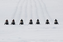 Baring Bay, Nunavut. 19 April 2012 – Canadian Rangers, riding snowmobiles, move over the high arctic tundra on a sovereignty patrol during Operation NUNALIVUT 2012. (Photo by Sgt Matthew McGregor, Canadian Forces Combat Camera).