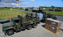Members from Canadian Armed Forces Disaster Assistance Response Team (DART) and the Philippines Army load DART equipment on trucks during Operation RENAISSANCE, in Iloilo city, Philippines on November 16, 2013. IS2013-2006-010.jpg Photo : MCpl Marc-Andre Gaudreault, Canadian Forces Combat Camera