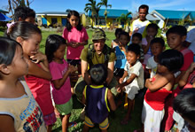 Corporal Joel Majaralie from 2 Combat Engineer Regiment, Petawawa plays with the local children during Operation RENAISSANCE, in Pontevedra, Philippines on November 24, 2013. Photo: MCpl Marc-Andre Gaudreault, Canadian Forces Combat Camera IS2013-2006-096