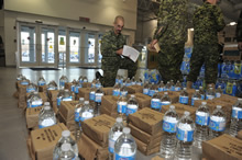 Sergeant Pascal Johanny from 4 Engineer Support Regiment takes inventory of rations and water at Canadian Armed Forces Base Trenton on November 13, 2013 to ensure there is enough for every soldier prior to embarking on a plane with other members of the Disaster Assistance Response Team, to help the Philippine Islands that were ravaged by Typhoon Haiyan. Photo IS2013-3042-01: MCpl Patrick Blanchard, Canadian Forces Combat Camera