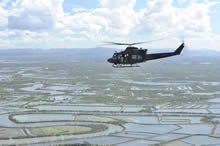 A CH-146 Griffon Helicopter, flies over the province of Capiz, Philippines on November 24, 2013 days after the area was devastated by Typhoon Haiyan, one of the largest typhoons on record. Corporal Darcy Lefebvre, Canadian Forces Combat Camera Photographer IS2013-6014-05