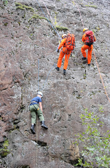Val-d'Or, Quebec. 17 September 2012 – Search and Rescue technician, Master Corporal Marco Journeyman (centre), from 424 Transport and Rescue Squadron in Trenton, Ontario and scenario supervisor, Sergeant Bill Kelland, from The Canadian Forces School of Search and Rescue in Comox, British Columbia, rappel down a rock face to rescue a stranded mock casualty during the National Search and Rescue Exercise (SAREX) 2012 near Val-d'Or, Quebec. (Photo by: Sergeant Matthew McGregor, Canadian Forces Combat Camera © 2012 DND-MDN Canada)