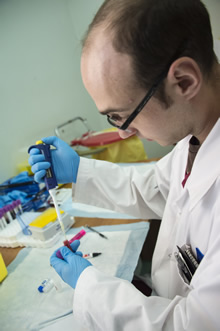 Sgt Sebastien Pellan, a Medical Laboratory Technologist with Joint Task Force Forward, tests blood samples provided by Syrian refugees during the medical screening portion of the Government of Canada's Operation PROVISION in Beirut, Lebanon on December 9, 2015.  Photo: Corporal Darcy Lefebvre, Canadian Forces Combat Camera.