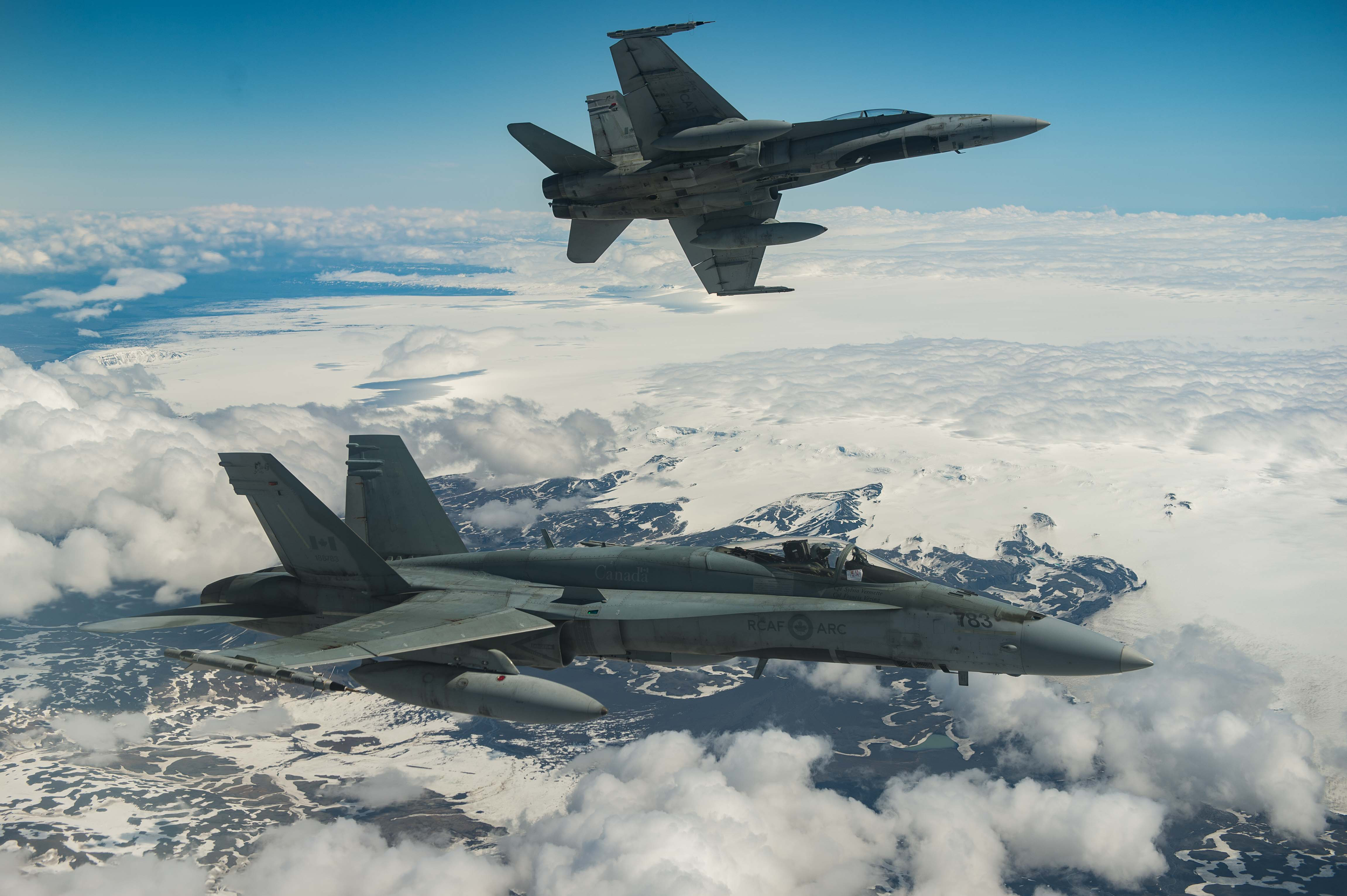 Two Royal Canadian Air Force CF-188 Hornet fighters from 433 Tactical Fighter Squadron fly over Iceland on May 31, 2017 during an Operation REASSURANCE surveillance mission.  (Photo: Corporal Gary Calvé. Imagery Technician ATF-ICELAND)
