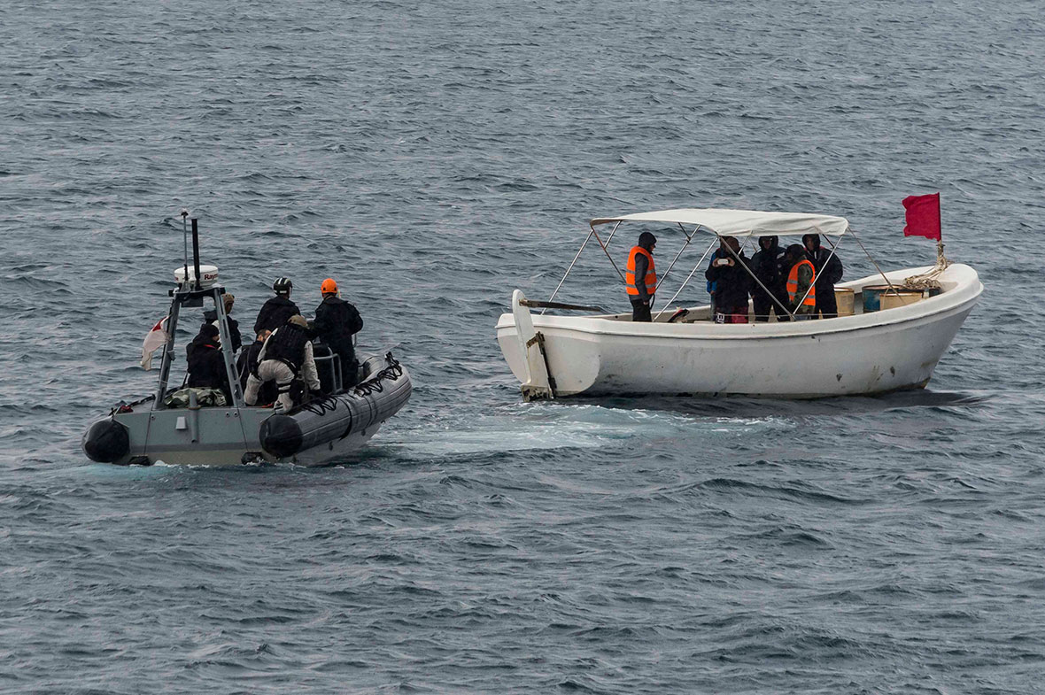 Crew members from HMCS Charlottetown, in the ship's Rigid Hull Inflatable Boat (RHIB) approach a simulated migrant vessel while conducting a refugee rescue training serial during EXERCISE NAIAS off the coast of Crete, Greece, December 16, 2016. (Photo: Cpl Blaine Sewell, Formation Imagery Services)