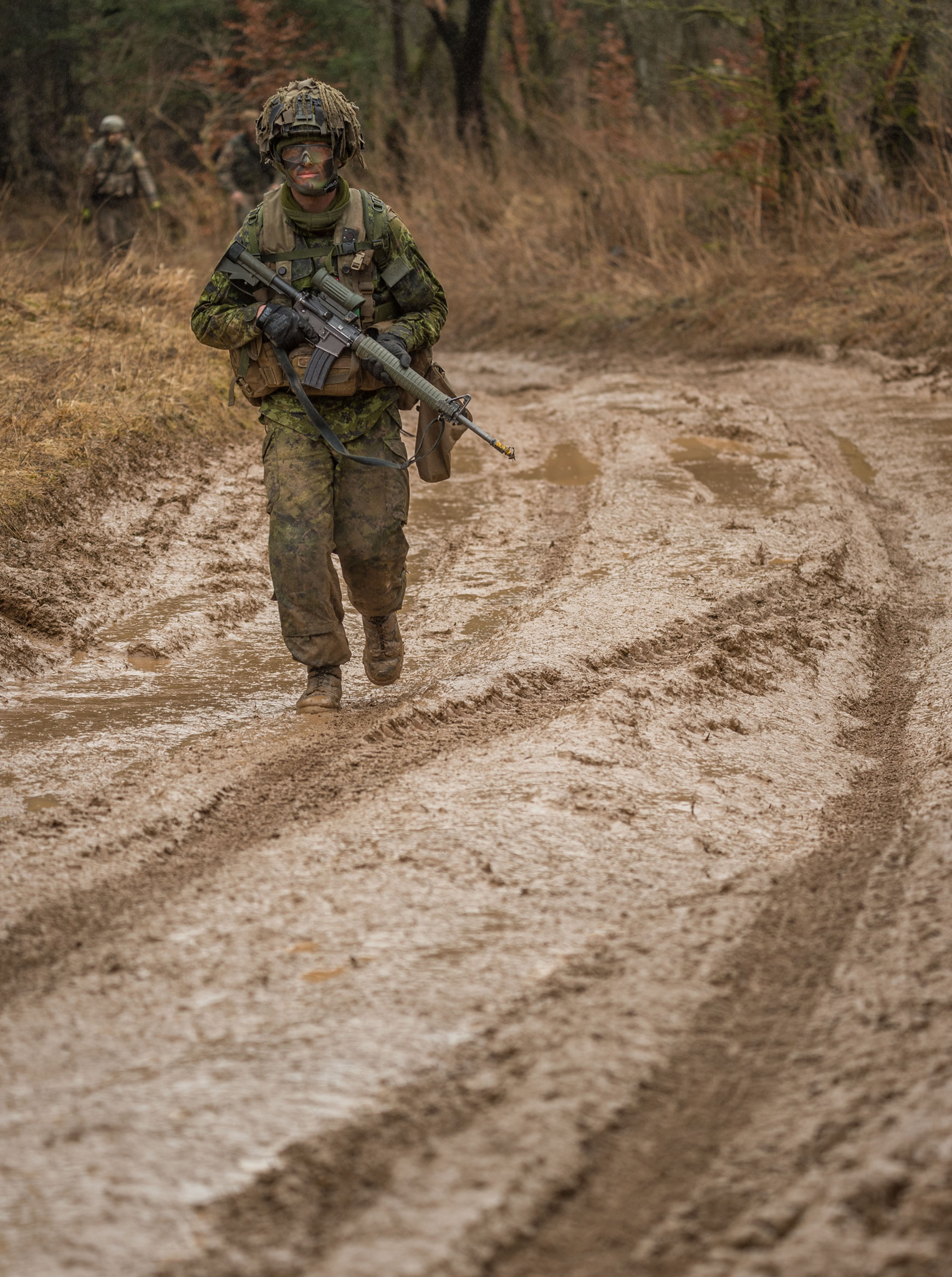Hohenfels, Germany. March 16, 2017 – A member of  the Forward Support Group doesn't let the mud slow him down in the Hohenfels Training Area, Germany on Exercise ALLIED SPIRIT VI during Operation REASSURANCE .
