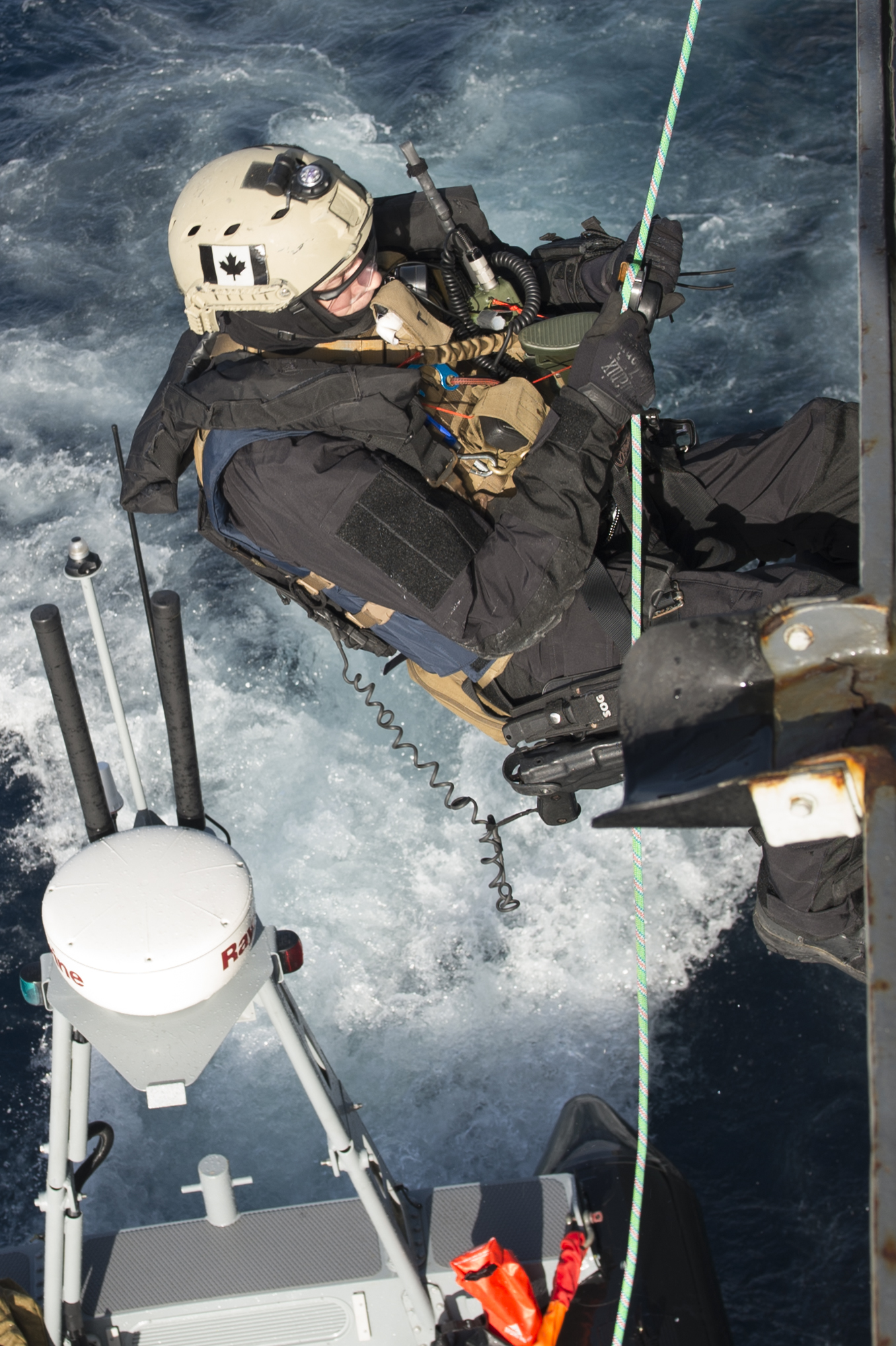 January 13, 2017. A member of the Maritime Tactical Operations Group repels off Her Majesty's Canadian Ship (HMCS) ST JOHN'S as the ship transits across the Atlantic Ocean to participate in Operation REASSURANCE on January 13, 2017. (Photo: Leading Seaman Ogle Henry, Formation Imaging Services)