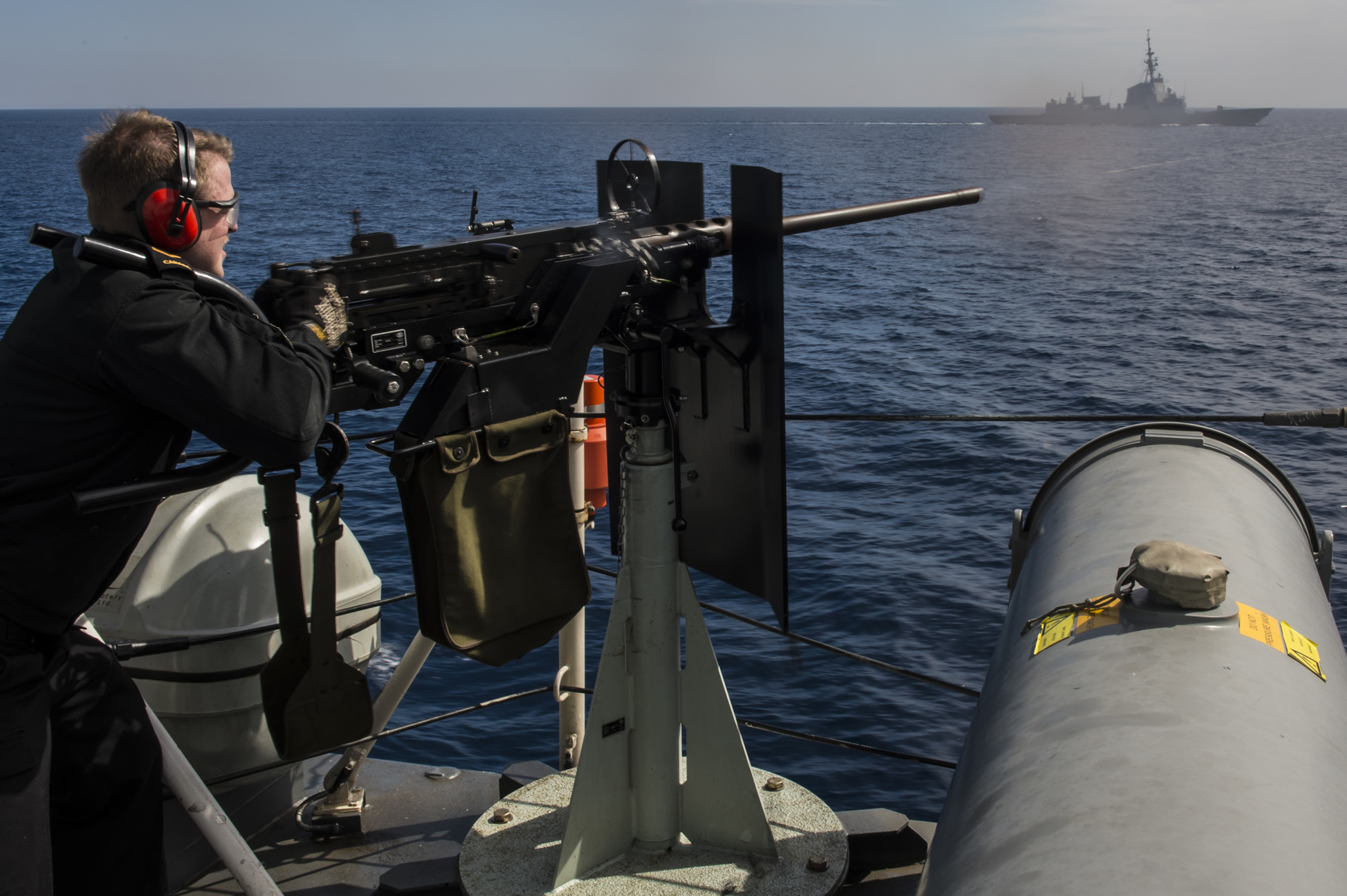 Mediterranean Sea. March 21, 2017 – Boatswain Able Seaman (AB) Kyle Hutchinson operates the .50 Calibre Heavy Machine Gun during a warning shot exercise onboard Her Majesty's Canadian Ship (HMCS) St. John's as it transits the Mediterranean Sea during Operation REASSURANCE. (Image by Leading Seaman Ogle Henry, Formation Imaging Services)