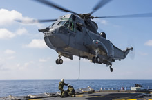 Crewmembers conduct hoisting exercises with the CH-124 Sea King helicopter onboard Her Majesty's Canadian Ship (HMCS) ST JOHN'S as the ship transits the Mediterranean Sea on March 29, 2017 during Operation REASSURANCE. (Photo: Leading Seaman Ogle Henry, Formation Imaging Services)