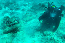 Solomon Islands. September 25, 2016 – Royal Canadian Navy sailor Leading Seaman Josh Adams, of Fleet Diving Unit – Pacific, prepares to dispose of unexploded projectiles found underwater on September 25, 2016, near Aeaun Island in the Solomon Islands during Operation RENDER SAFE. (Photo by Australian Defence Forces)
