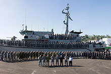 Members of Combined Joint Task Force 663, including military members from Australia, Canada, New Zealand, and the United Kingdom and members of the Royal Solomon Islands Police Force, gather in front of Her Majesty's Australian Ship Diamantina in September 2016 in Honiara, Guadalcanal Island, Solomon Islands during Operation RENDER SAFE 2016. (Photo: Australian Defence Force)