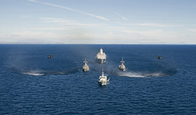 Off the coast of Southern California. 17 July 2014 - San Antonio-class amphibious transport dock ship USS Anchorage (LPD 23), Avenger-class mine countermeasures ships USS Scout (MCM 8) and USS Champion (MCM 4), and Canadian Forces Kingston-Class coastal defense vessel HMCS Nanaimo (MM 702 - front) transit in formation off the coast of Southern California as part of Rim of the Pacific (RIMPAC) Exercise 2014. (U.S. Navy photo: Chief Mass Communication Specialist Mark C. Schultz/Released)