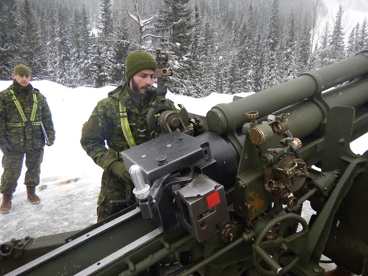Roto 2 taking their first sight of the avalanche zones on Rogers Pass on one of the C3 105-mm Howitzers at a road-side gun platform.