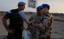Sector 4, Buffer Zone, Cyprus. 24 November 2008 – Captain Michael Solonynko, Operation and Information Analyst Officer for the UN HQ in Cyprus, discusses the route to the next location with Captain Slovomir Smidl from Slovakia (right) and Lieutenant Laslo Cziko from Hungary. (photo by: MCpl Robert Bottrill, Canadian Forces Combat Camera)