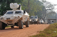 Yambio, South Sudan. 4 December 2012 – From his armour personnel carrier (APC), a soldier from Rwanda watches from the turret as the convoy departs the United Nations (UN) camp in Yambio, South Sudan. (Photo by Sgt Norm McLean Canadian Forces Combat Camera)
