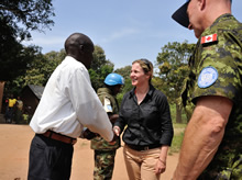 Yambio, South Sudan. 4 December 2012 – Catherine Fleming, Head of the stabilization office of the Embassy of Canada for South Sudan, and Commander Paul Earnshaw, Canadian military liaison officer in the United Nations Mission in the Republic of South Sudan (UNMISS) greet Mister Paulino Mangbondo, payam administrator, from the village of Sakure, near the Congo border during Operation SOPRANO. (Photo : Sgt Norm McLean, Canadian Forces Combat Camera)