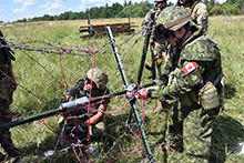 Canadian and Ukrainian Combat Engineers prepare explosive charges during obstacle demolition training at the International Peacekeeping and Security Centre in Starychi, Ukraine, on August 20, 2016. (Photo: Joint Task Force Ukraine)