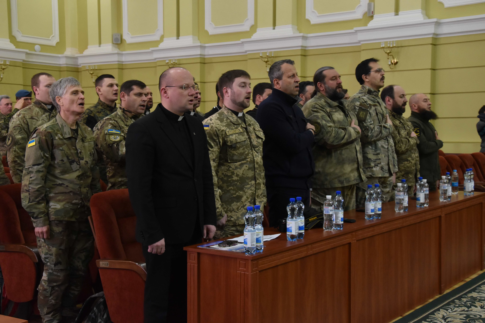 Lviv, Ukraine. February 10, 2017 – Ukrainian religious leaders taking part in the Joint Task Force - Ukraine chaplain development course sing the national anthem during a ceremony at the Hetman Petro Sahaidachny National Army Academy in Lviv, Ukraine, on February 10, 2017. (Photo : Joint Task Force – Ukraine)