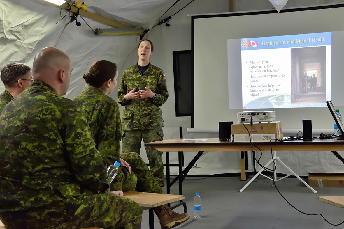 Captain Samantha Thompson, a Canadian Armed Forces Social Work Officer, discusses mental health with members of Operation UNIFIER Rotation 2 before they return to Canada at the International Peacekeeping and Security Centre in Starychi, Ukraine, on February 21, 2017. (Photo: Joint Task Force – Ukraine)
