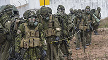 Tancos, Portugal. 25 October 2015 – Members of A Company (Airborne) 3rd Battalion, Royal 22e Régiment go through decontamination drill after a Chemical, Biological, Radiological, Nuclear and Explosives (CBRNE) scenario in Tancos, Portugal during JOINTEX 15 as part of NATO's Exercise Trident Juncture 15. (Photo: Corporal Alex Parenteau, Canadian Forces Combat Camera)