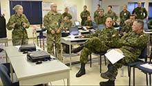Meaford, Ontario. 14 October 2015. Major Janie Desjardins (left) briefs General Jonathan Vance, Chief of Defence Staff, about the current exercise scenario during a visit to the Canadian Multinational Task Force Headquarters for JOINTEX 15 at 4th Canadian Division Training Centre Meaford, Ontario. (Photo: Master Corporal Simon Duchesne, JOINTEX 2015 Imagery Technician)