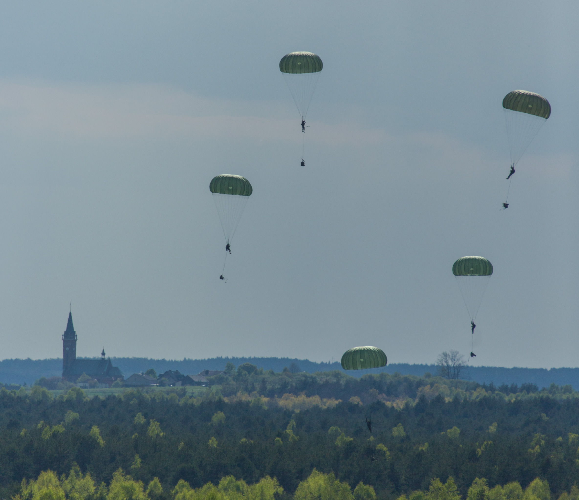 Blendowska, Poland. 5 May 2014 – Canadian jumpers from 3rd Battalion, Princess Patricia's Canadian Light Infantry jump from a Royal Canadian Air Force CC-130 Hercules during Exercise ORZEL ALERT.