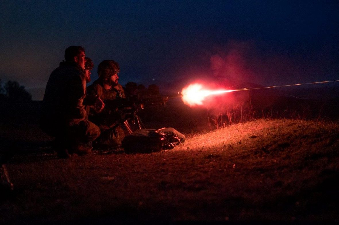 "Members of C Coy 3 PPCLI deployed on OP REASSURANCE fire the C6 machine gun at night during Ex PLATINUM EAGLE which took place in Babadag, Romania"" (Photo: Cpl J.P.D. Laviolette)"