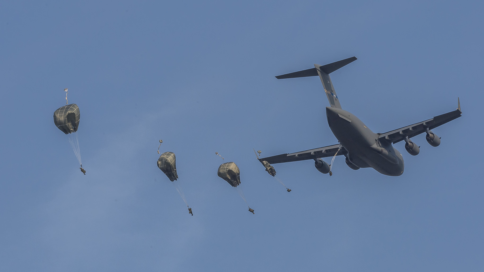 Hohenfels, Germany. 13 August 2015 – Canadian paratroopers jump from a C-130J Hercules aircraft during a joint parachuting exercise at the Joint Multinational Readiness Center in Hohenfels, Germany, on August 13, 2015, during Operation REASSURANCE. (Photo: Corporal Nathan Moulton, Land Task Force Imagery)