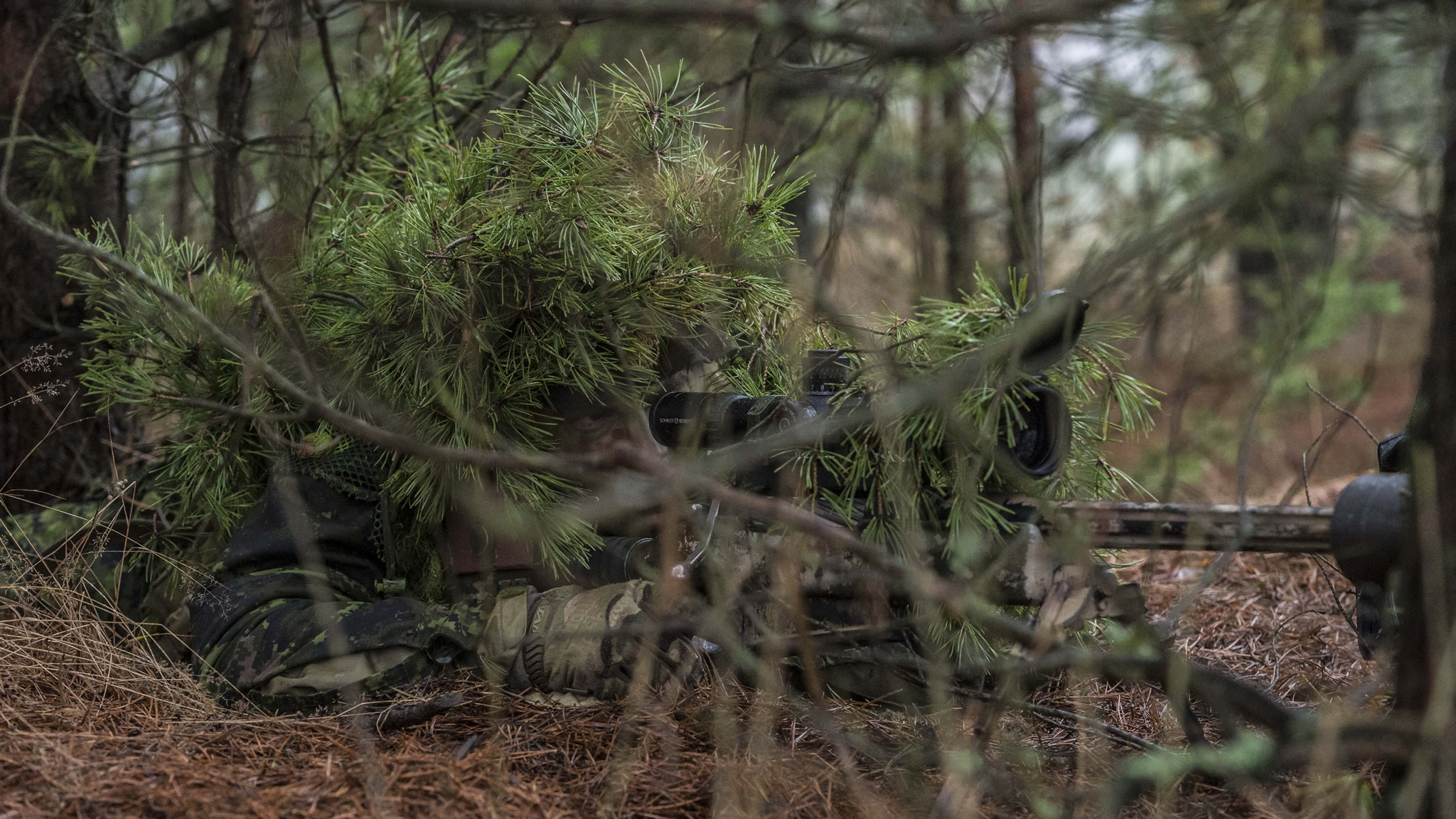A Canadian Armed Forces sniper looks through his scope while participating in Exercise Without Warning in the training area of Glebokie, Poland on December 17, 2015 during Operation REASSURANCE. (Photo: Corporal Nathan Moulton, Land Task Force Imagery, OP REASSURANCE)
