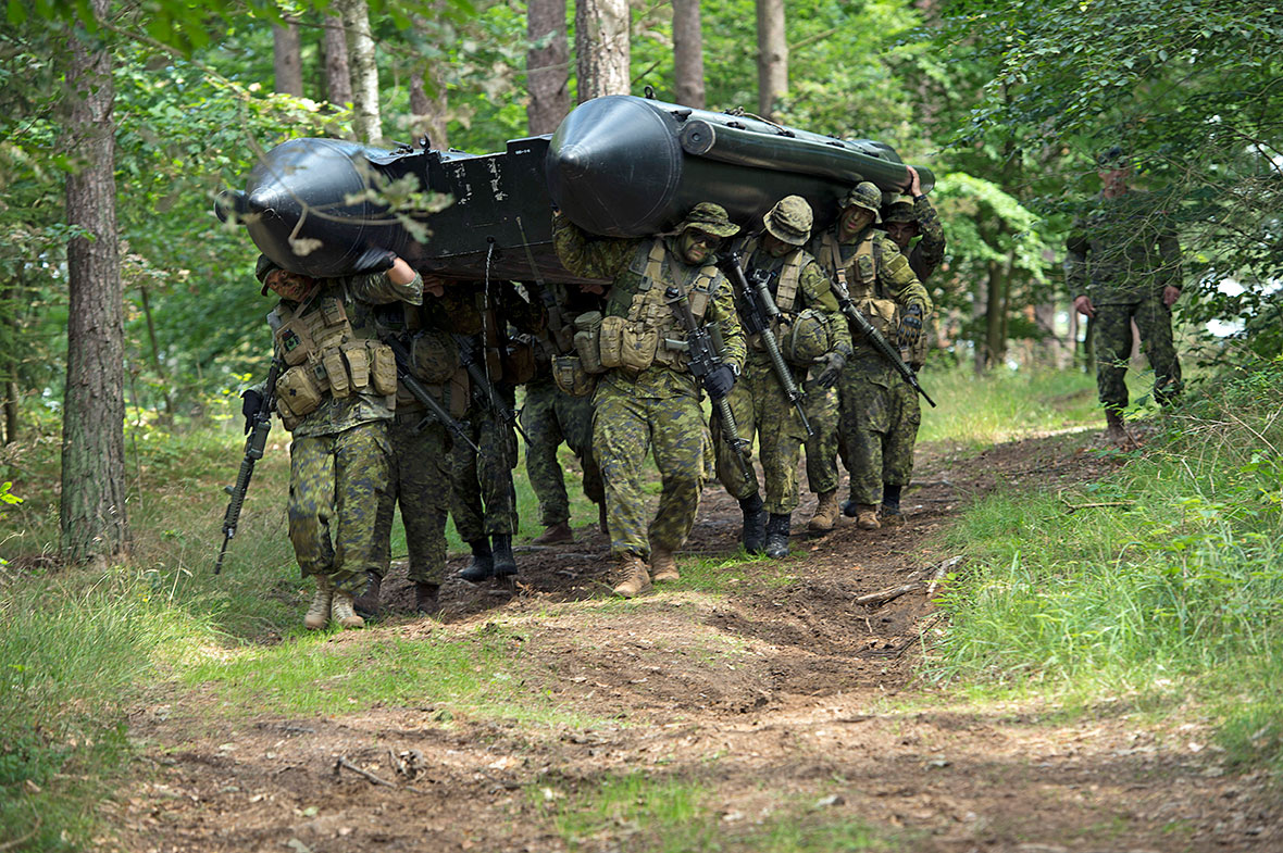 August 4 2016. Canadian soldiers move a rigid hull inflatable boat at the start of an ambush training scenario at the Drawsko Pomorskie Training Area in Poland on August 4, 2016 during Operation REASSURANCE. (Photo: Captain Mark Ruban, Operation REASSURANCE Land Task Force Public Affairs Officer)