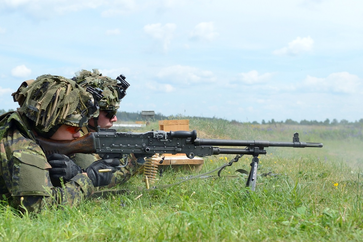 Canadian Armed Forces members from C-Company, 3rd Battalion Princess Patricia's Canadian Light Infantry, (3PPCLI) fire a C6 machine gun during a live fire range during Exercise SABRE STRIKE on June 6, 2017 as part of Operation REASSURANCE.