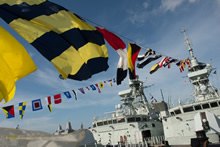 July 01, 2016. Her Majesty's Canadian Ship (HMCS) Calgary and HMCS Vancouver hoist their signal flags in celebration of Canada Day at Joint Base Pearl Harbour-Hickam, Hawaii for RIMPAC 16 on July 01, 2016. (Photo: MCpl Chris Ward, MARPAC Imaging Services)