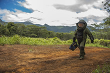"Wahiawa, Hawaii, USA. 29 July 2016 – A member of the Canadian Armed Forces Explosive Ordnance Disposal (EOD) personnel walks towards his mission objective during a vehicle borne improvised explosive device (VBIED) scenario as part of RIMPAC 16 at K bay, ""Boondocker"" range. (Photo:  MCpl Mathieu Gaudreault, Canadian Forces Combat Camera)"