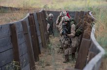 San Diego, California. 31 July 2016 – Members from 2e Bataillon, Royal 22e Régiment advance into a trench during RIMPAC 2016 at Camp Pendleton. (Photo by: Sgt Marc-André Gaudreault, Valcartier Imaging Services)