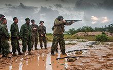 Belize. 18 June 2015 - Warrant Officer Jocelyn Roy from the Royal 22e Regiment, provides a shotgun demonstration for the soldiers from the Belize Defence Force and members of the United States Marine Corps participating in marksmanship shotgun training during phase II of Exercise TRADEWINDS 15. (Photo: Sgt Yannick Bédard, Canadian Forces Combat Camera)