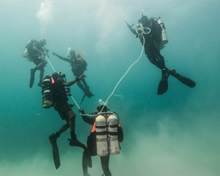 Discovery Bay, Jamaica. June 8 2016. Caribbean divers take their position prior a bottom search practice during Exercise TRADEWINDS in Discovery Bay, Jamaica on June 8, 2016. (Photo: Sgt Yannick Bédard, Canadian Forces Combat Camera)