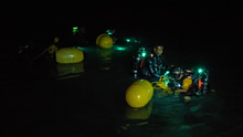 Discovery Bay, Jamaica. June 8 2016. Caribbean divers perform a leak check before a night dive during Exercise TRADEWINDS in Discovery Bay, Jamaica on June 8, 2016. (Photo: Sgt Yannick Bédard, Canadian Forces Combat Camera)