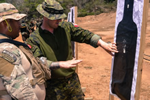 Master Corporal Joel Sutherland instructs a soldier from the Belize Army in shooting drills at the Jamaican Defense Forces Gallery Range during Exercise TRADEWINDS 16 in Kingston, Jamaica on June 23, 2016. (Photo: MCpl McMillan, Combat Camera)