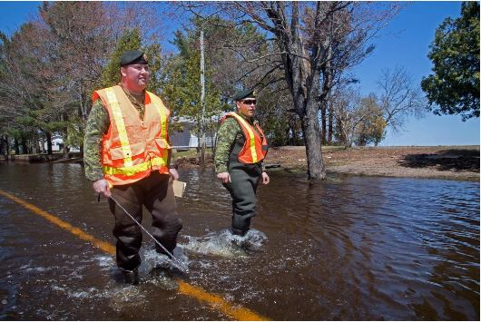 Members of 4 Engineer Support Regiment conduct infrastructure assessment operations throughout affected flooded areas to assist in recovery efforts in Grand Lake, New Brunswick during Operation LENTUS, May 13, 2018. Photo: Sgt Lance Wade LH01-2018-0026-018