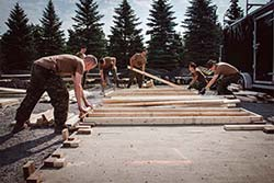Soldiers with Joint Task Force (East) build wood floors to be installed in the tents erected to accommodate asylum seekers near the Saint-Bernard-de-Lacolle border crossing in Quebec during Operation ELEMENT, August 11, 2017. Photo: Corporal Djalma Vuong-De Ramos, BAP 2 DIV CA / JTF (East)