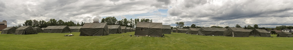 A panorama of the tent city erected by the Royal Canadian Dragoons at the Nav Canada Center in Cornwall, Ontario during Operation ELEMENT, August 18, 2017. Photo: Cpl Veldman, Garrison Imaging Petawawa