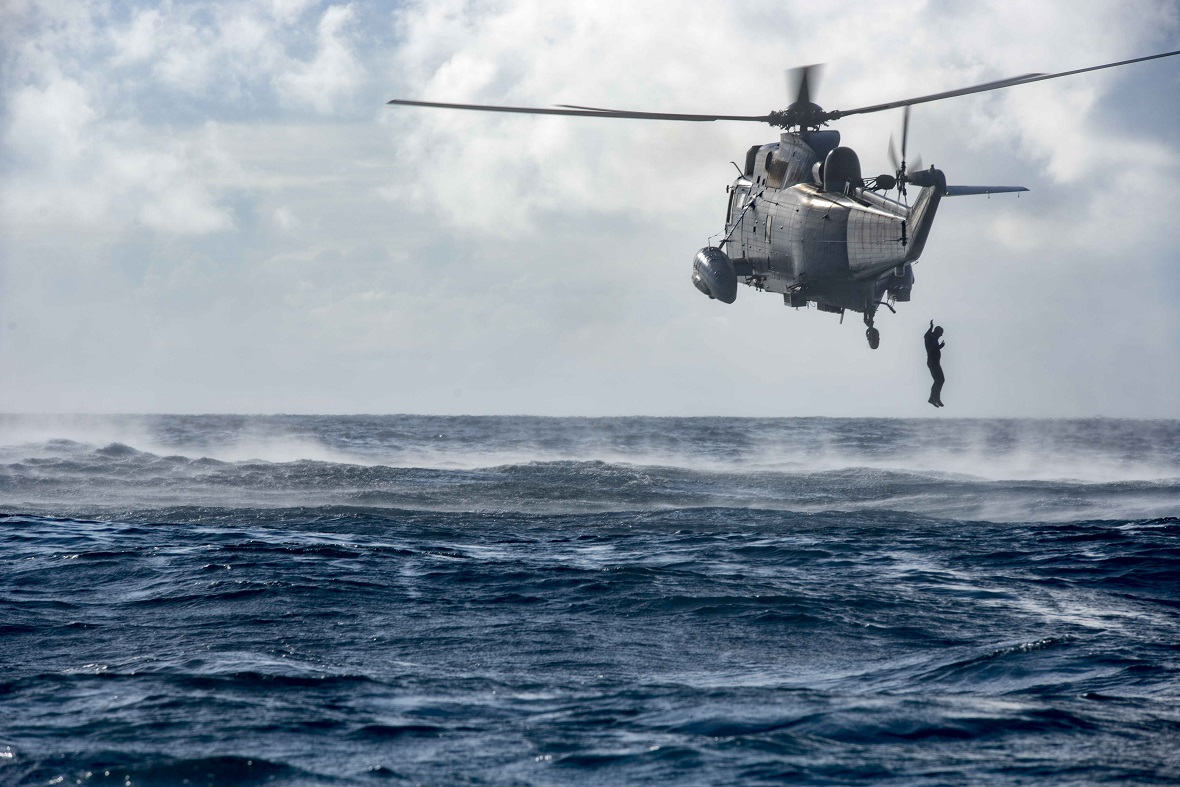 Members of the Her Majesty's Canadian Ship CHARLOTTETOWN dive team jump from a CH-124 Sea King Helicopter into the Atlantic Ocean for a training activity during Operation REASSURANCE on August 14, 2017. Image by Corporal J.W.S. Houck - Formation Imaging Services