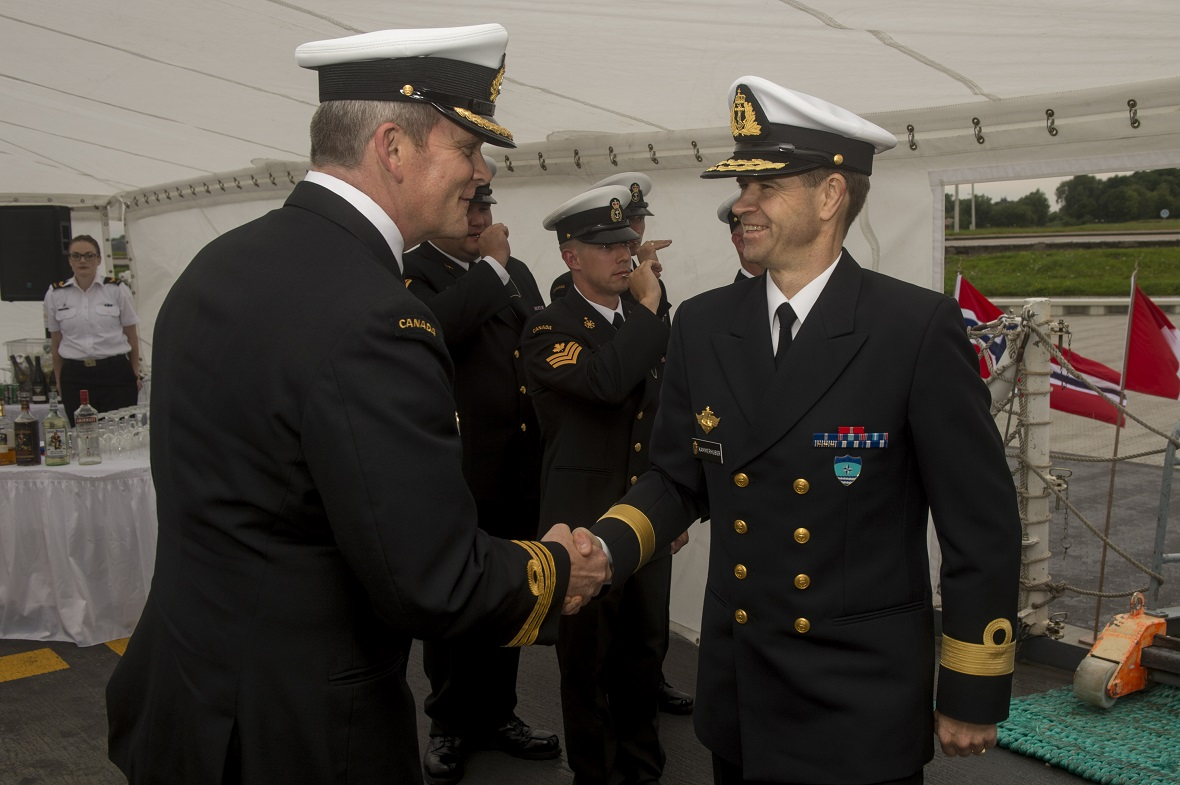Commander Jeff Hutt, Commanding Officer of Her Majesty's Canadian Ship (HSMC) Charlottetown, welcomes Commodore Petter Kammerhuber, Commander of the Standing NATO Maritime Group 1, during a function aboard HMCS Charlottetown for Allied countries involved with Operation REASSURANCE at the Naval Base Wilhelmshaven, Germany on August 18, 2017.  Photo: Corporal J.W.S. Houck, Formation Imaging Services