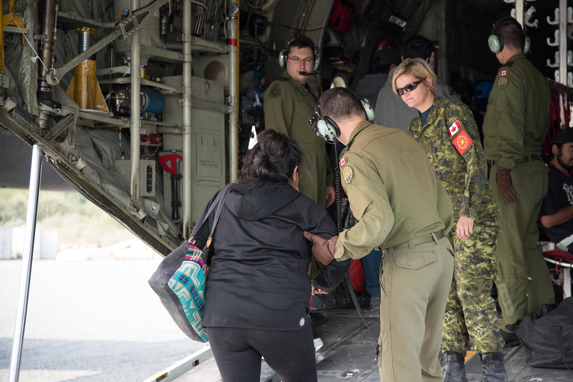 Two CC-130H Hercules aircraft from 435 Transport and Rescue Squadron based at 17 Wing Winnipeg assist in the evacuation of people from communities in northern Manitoba affected by forest fires as part of Operation LENTUS on August 31, 2017. Photo: Cpl Justin Ancelin, 17 Wing Imaging