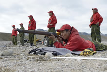 Baffin Island, Nunavut. 25 August 2014 - Jamie Pillaktuaq of 1 Canadian Ranger Patrol Group does a test sighting to ensure that there are no obstacles, on the .303 Lee Enfield Rifle range at York Sound on Baffin Island, NU, during OP NANOOK. (Photo by Cpl Aydyn Neifer, CFJIC Deployment Team A)